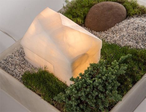 lamp that is shaped like a landscape of a house