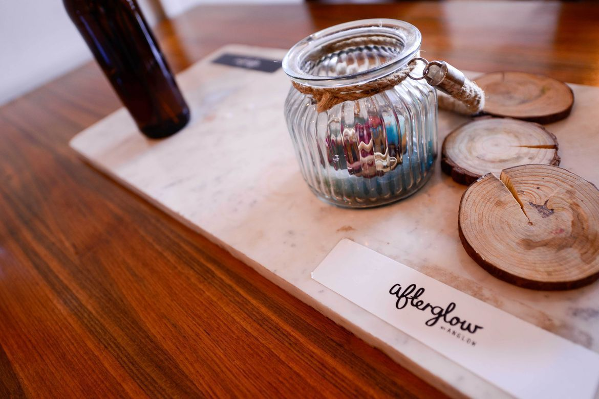 wooden tray and coasters at afterglow by anglow deli and bar