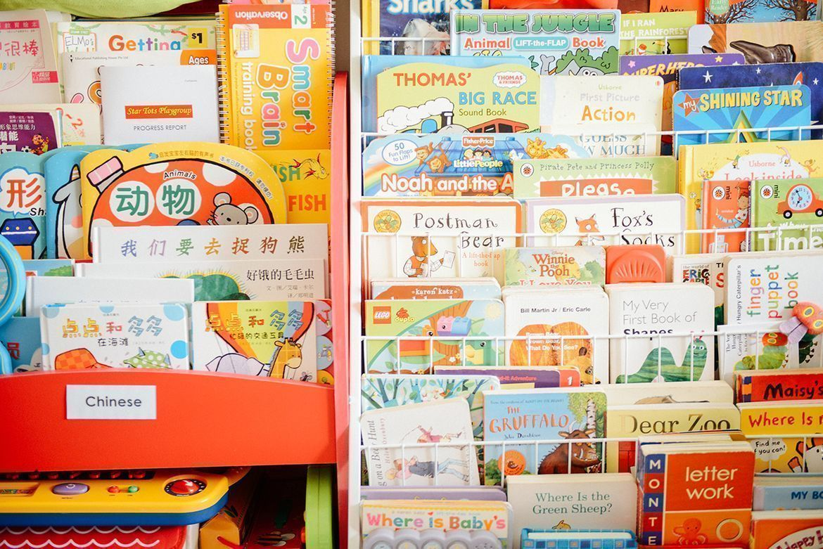 organized books and toys for a safe playroom for kids