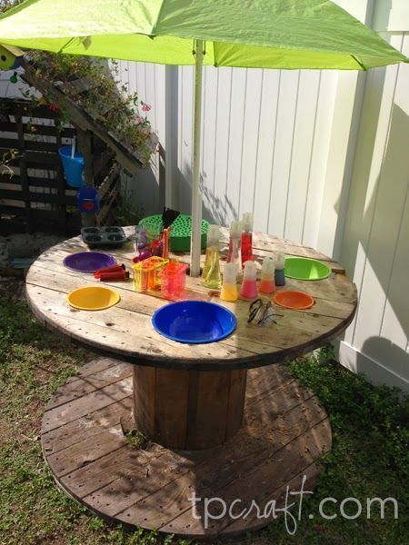 upcycled furnitures turn into outdoor play table for children