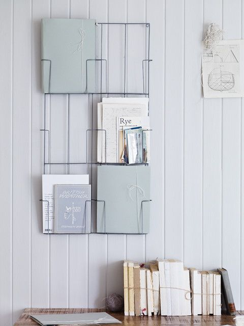 Video: How to Hang a Magazine Rack for the Home