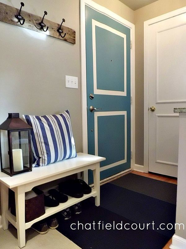 perfectly painted white and blue wooden door with moulding