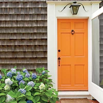orange paint front door - bright and cheery look and feel