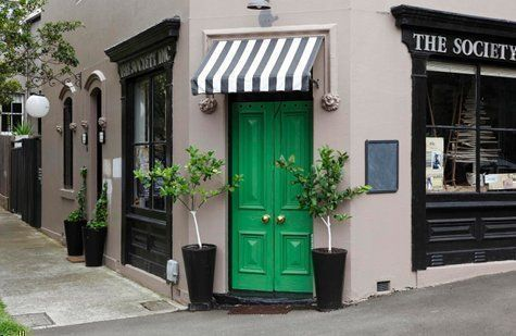 green front door gives off an inviting store