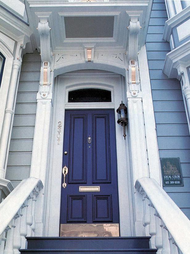 a dark coloured painted front door exudes elegance