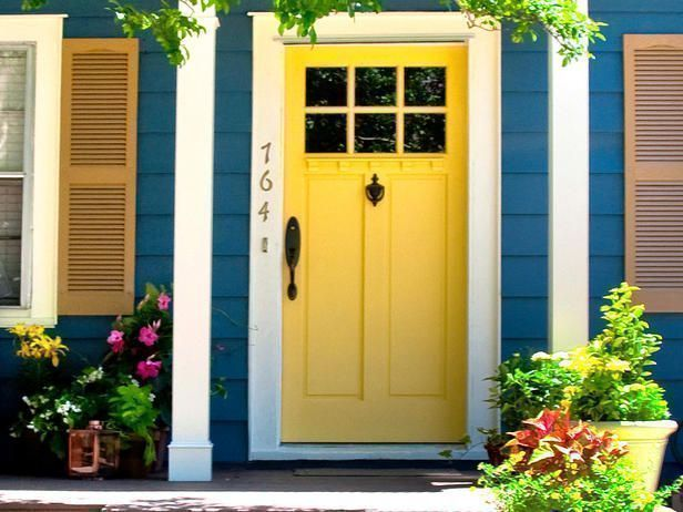 bright yellow front door is inviting and fun style