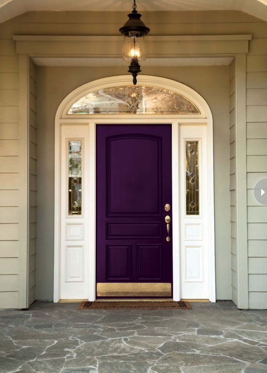 a deep purple painted front door exudes timeless elegance