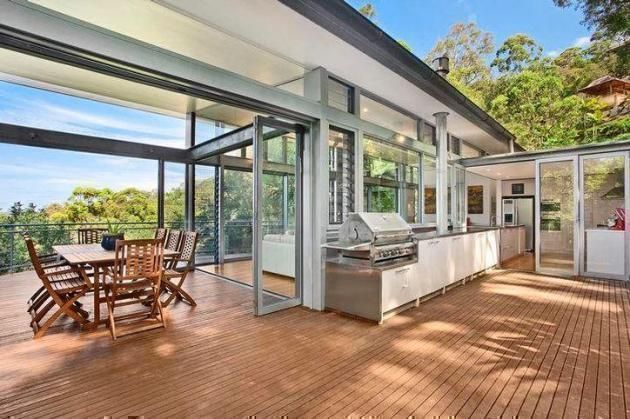 spacious and amazing outdoor patio with nature views in a glass house at Sydney
