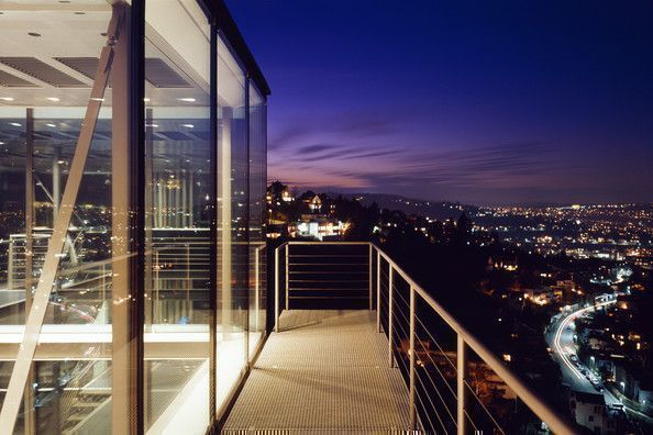 city view and night lights at modern glass house in Germany