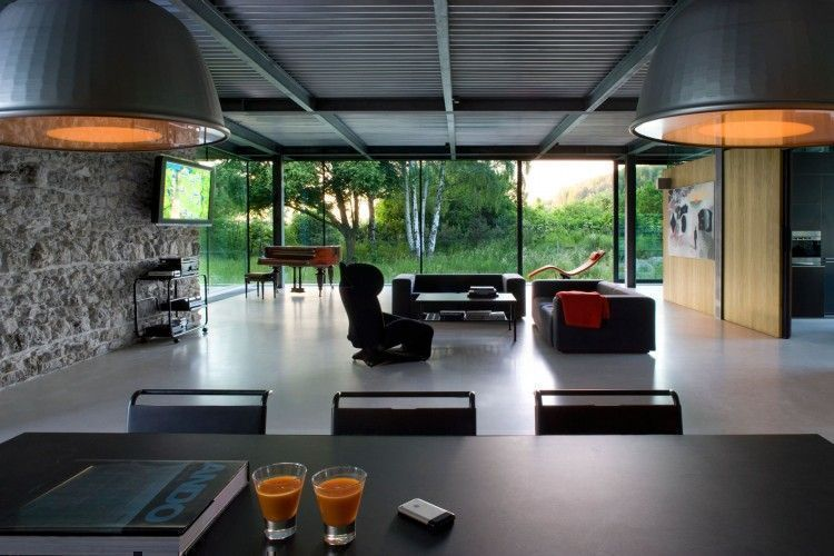 spacious, modern and luxurious living space in glass house at Poland