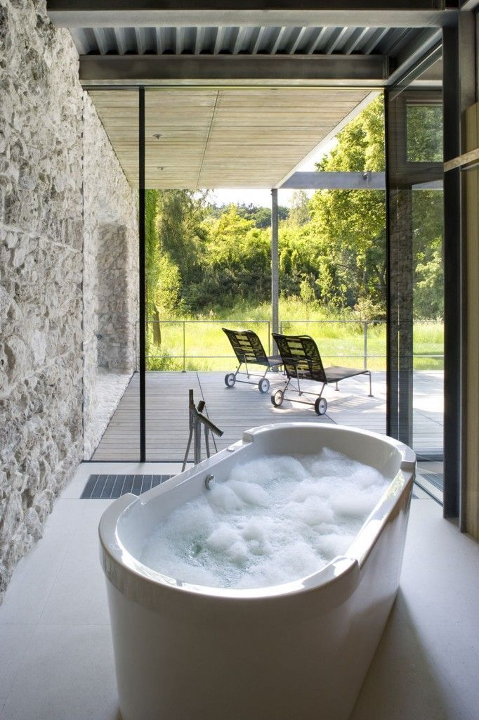 luxurious villa style bathroom with full glass view in a glass house at Poland