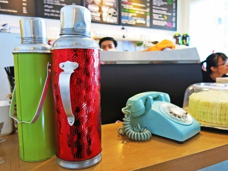 vintage flasks and decorative items at the daily coffee cafe