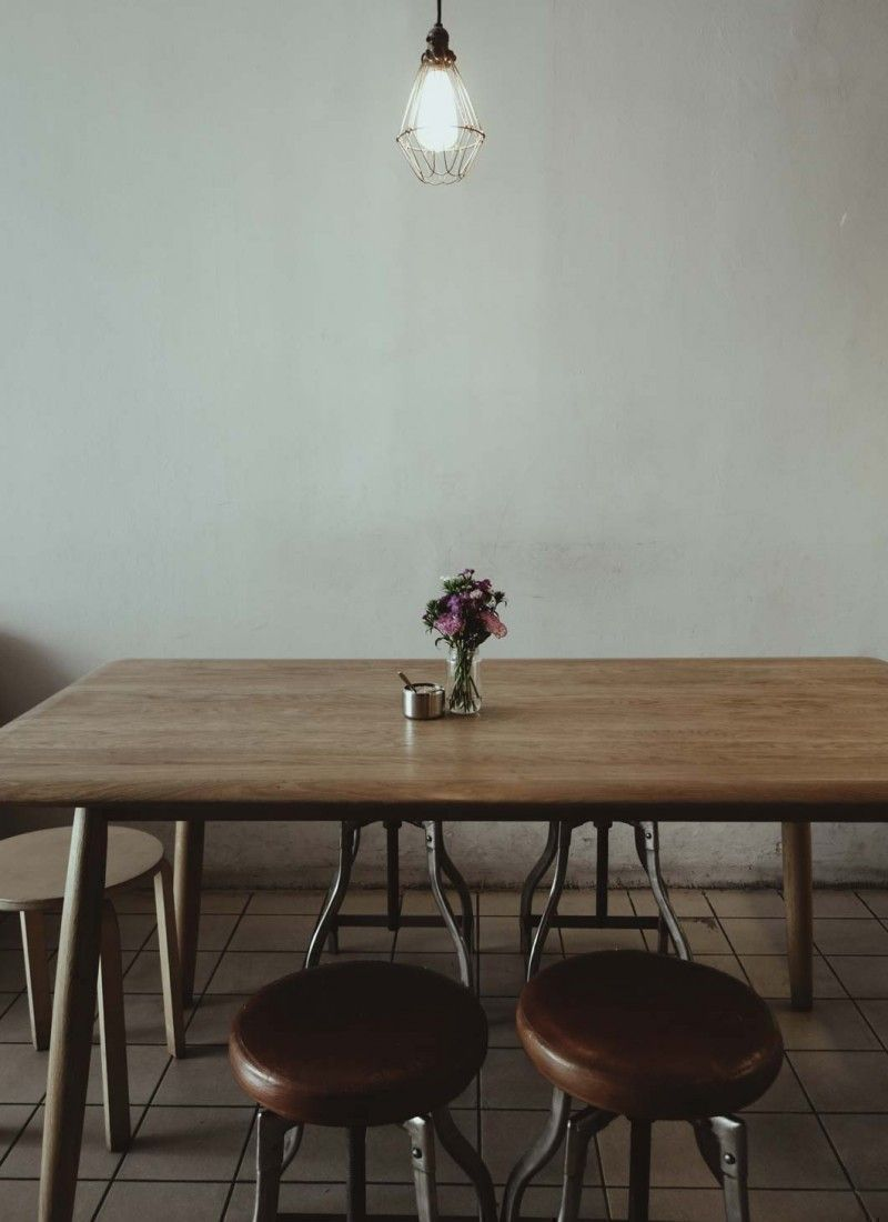 scandinavian minimalist dining table with dried flower decoration