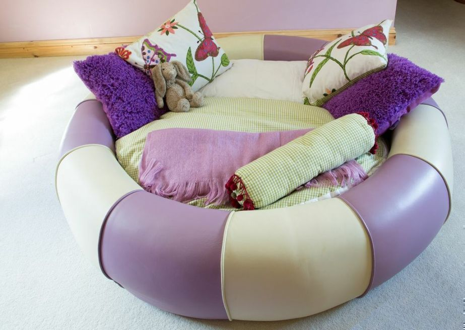 sweet purple and cream colour bed shape in a doughnut, resting bed for your little girl