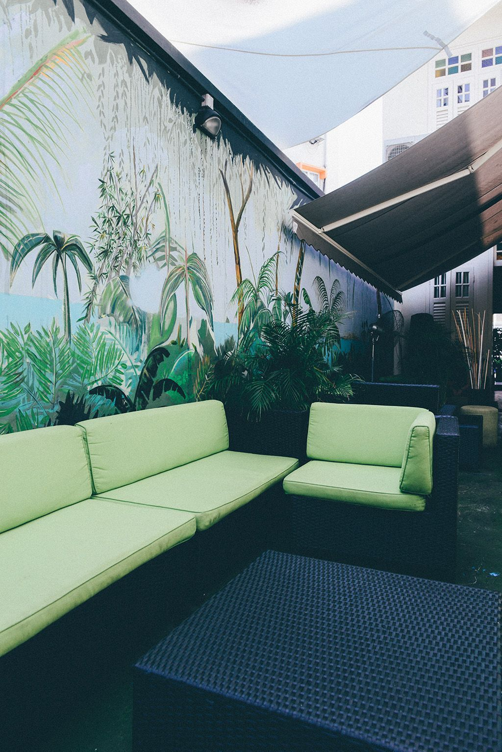 the tropical-inspired lounge area of lime house singapore