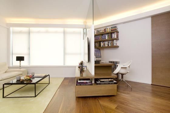 clear glass divider to divide the living and home office space