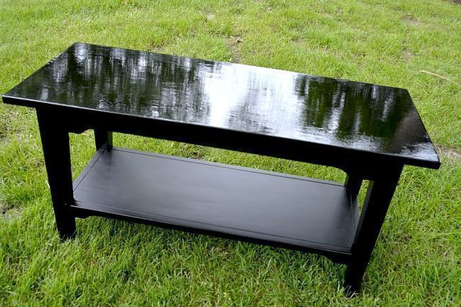 a painted black bench waiting to be upholstered