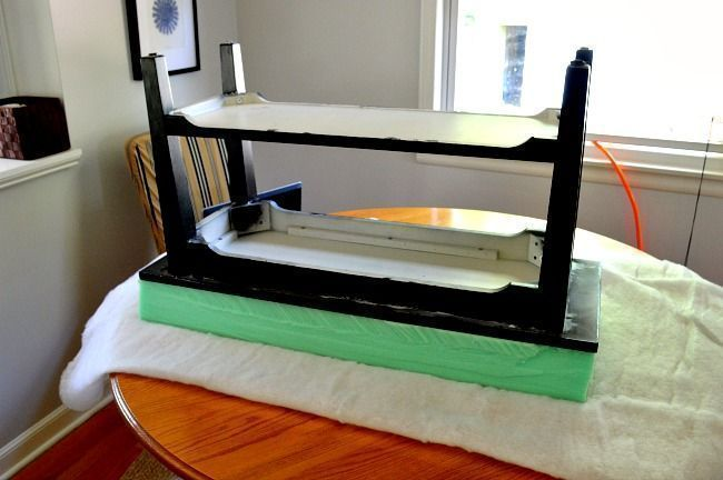 measuring and cutting dense foam to prepare for upholstering the bench