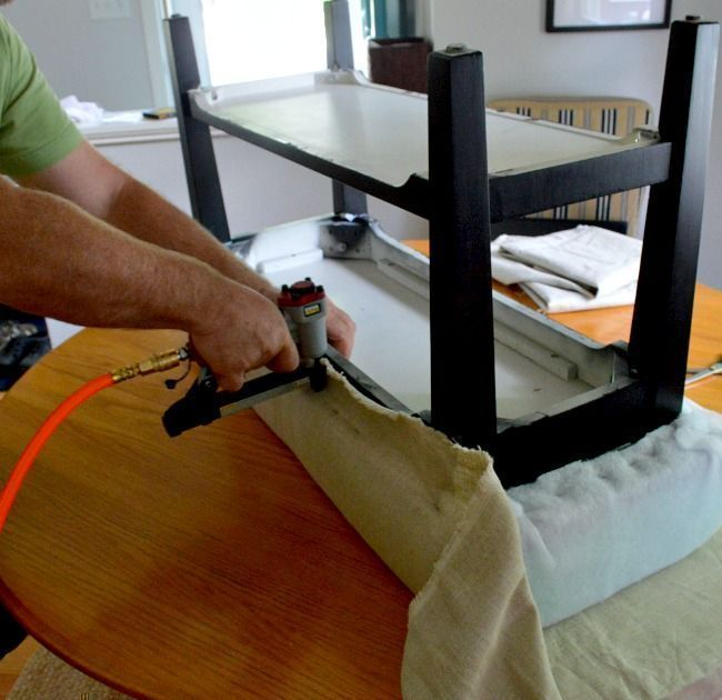 upholstering process - cover the fabric of choice over the stapled batting and secured dense foam